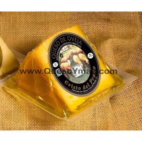 Cuña de Queso curado de oveja, con leche cruda y en Aceite de Oliva. (400 g. aprox.)